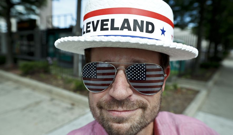 Andy Sandy wears an RNC hat and pair of American flag glasses while walking around, Sunday, July 17, 2016, in Cleveland. The Republican National Convention starts Monday. (AP Photo/Alex Brandon)